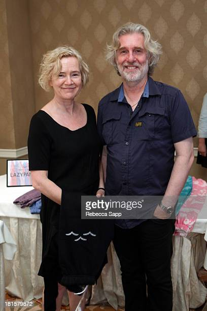 Producer Chris Newman and wife attend the HBO Luxury Lounge featuring Motorola and PANDORA Jewelry in honor of The 65th Primetime Emmy Awards at The...
