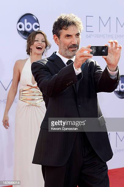 Producer Chuck Lorre and Emmanuelle Vaugier arrive at the 64th Annual Primetime Emmy Awards at Nokia Theatre LA Live on September 23 2012 in Los...