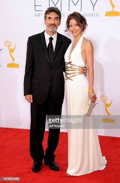 Producer Chuck Lorre and Emmanuelle Vaugier arrive at the 64th Primetime Emmy Awards at Nokia Theatre LA Live on September 23 2012 in Los Angeles...