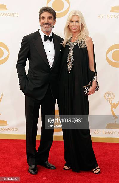 Producer Chuck Lorre and guest arrive at the 65th Annual Primetime Emmy Awards held at Nokia Theatre LA Live on September 22 2013 in Los Angeles...