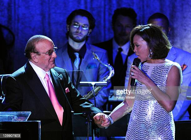 Producer Clive Davis and singer Whitney Houston speak onstage at the 2011 PreGRAMMY Gala and Salute To Industry Icons Honoring David Geffen at The...