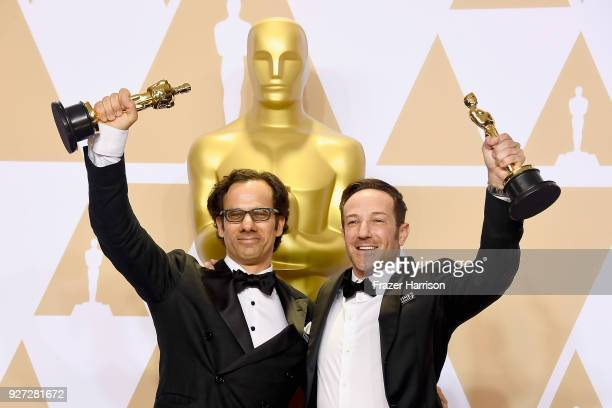 Producer Dan Cogan and director Bryan Fogel winners of the Best Documentary Feature award for 'Icarus' pose in the press room during the 90th Annual...