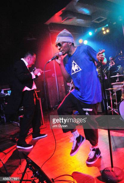 Producer Dan the Automator and rapper Del the Funky Homosapien of alternative hip hop supergroup Deltron 3030 perform live on stage with a 16piece...
