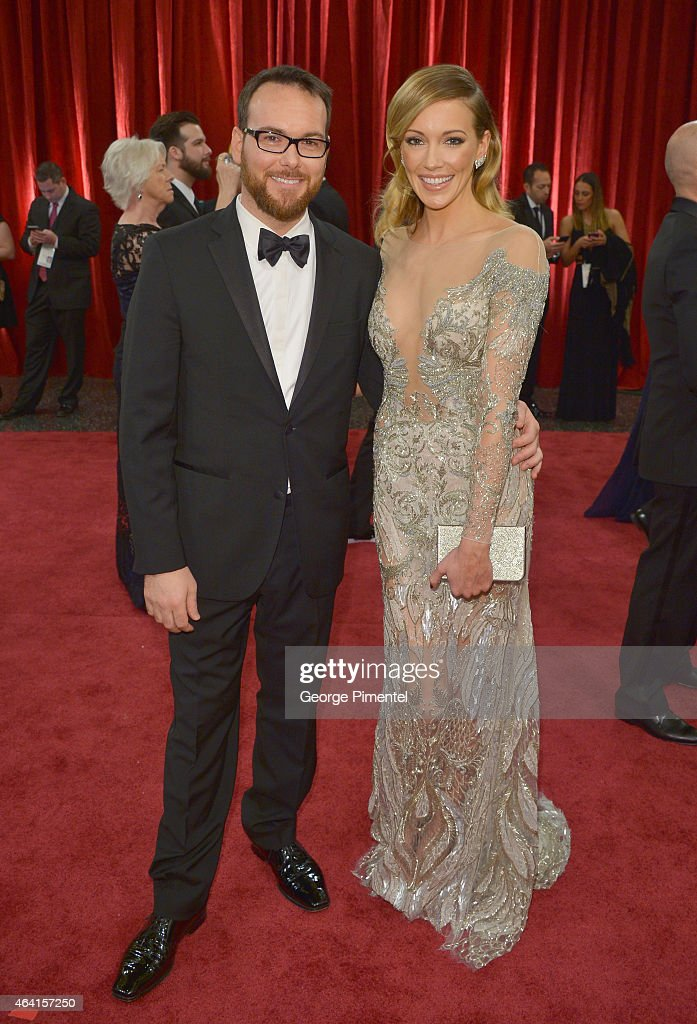 Producer Dana Brunetti (L) and actress Katie Cassidy attend the 87th Annual Academy Awards at Hollywood & Highland Center on February 22, 2015 in Hollywood, California.
