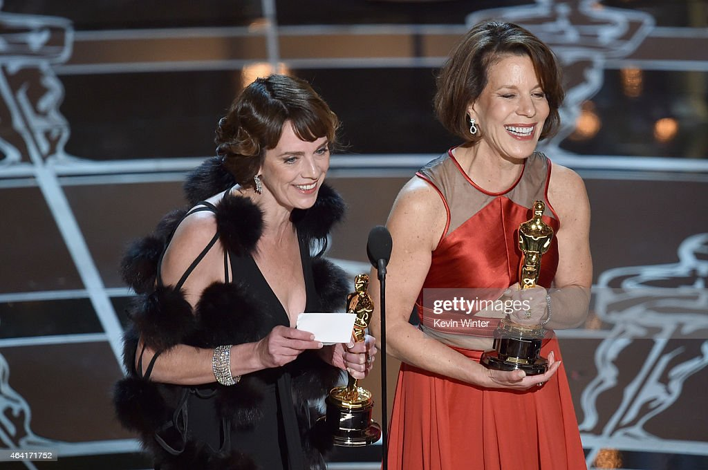 Producer Dana Perry and director Ellen Goosenberg Kent accept the Best Documentary Short Award for 'Crisis Hotline; Veterans Press 1' onstage during the 87th Annual Academy Awards at Dolby Theatre on February 22, 2015 in Hollywood, California.