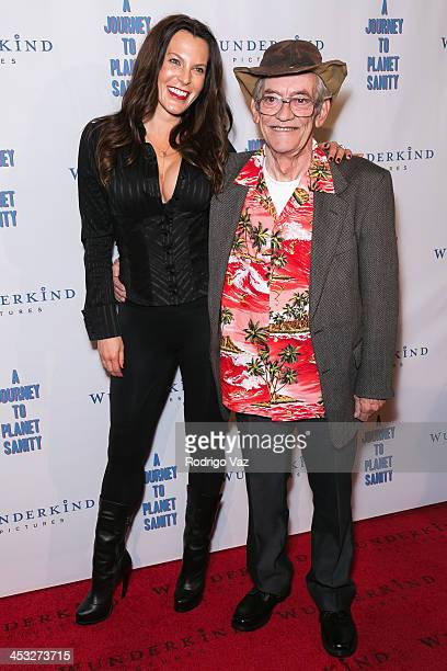 Producer Danielle Crane and LeRoy Tessina attend 'A Journey To Planet Sanity' Los Angeles Premiere at Laemmle Monica 4Plex on December 2 2013 in...