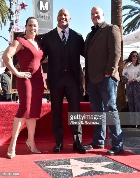 Producer Dany Garcia actor Dwayne Johnson and producer Hiram Garcia attend a ceremony honoring Dwayne Johnson with the 2624th star on the Hollywood...