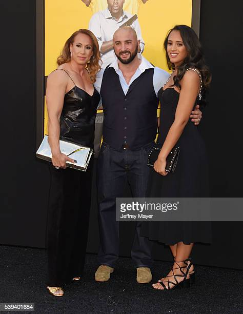 Producer Dany Garcia husband Dave Rienzi and Simone Johnson attend the premiere of Warner Bros Pictures' 'Central Intelligence' at Westwood Village...