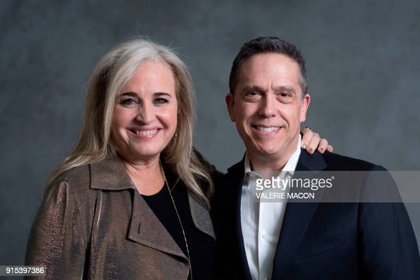 Producer Darla K Anderson and director Lee Unkrich pose for a portrait during the Academy Awards annual nominees luncheon for the 90th Oscars at the...
