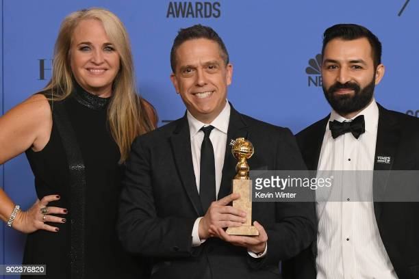 Producer Darla K Anderson director Lee Unkrich and Adrian Molina pose with the Best Motion Picture Animated for 'Coco' in the press room during The...