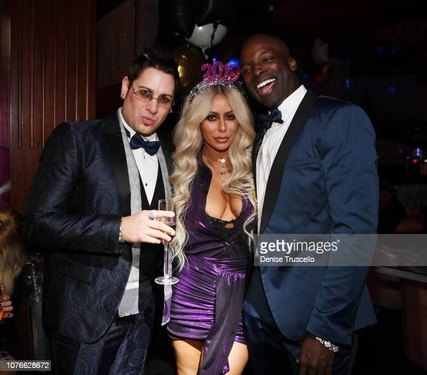Producer Dave Bryant and singer Aubrey O'Day and JD Murphy celebrate New Year's Eve at Hustler Club Las Vegas on December 31 2019 in Las Vegas Nevada