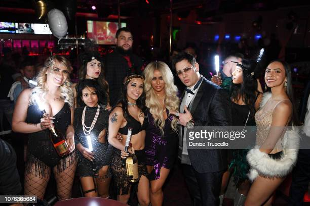 Producer Dave Bryant and singer Aubrey O'Day celebrate New Year's Eve at Hustler Club Las Vegas on January 1 2018 in Las Vegas Nevada