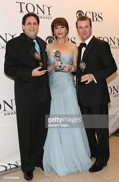Producer David Babani Catherine ZetaJones and Douglas Hodge attend the 64th Annual Tony Awards at The Sports Club/LA on June 13 2010 in New York City