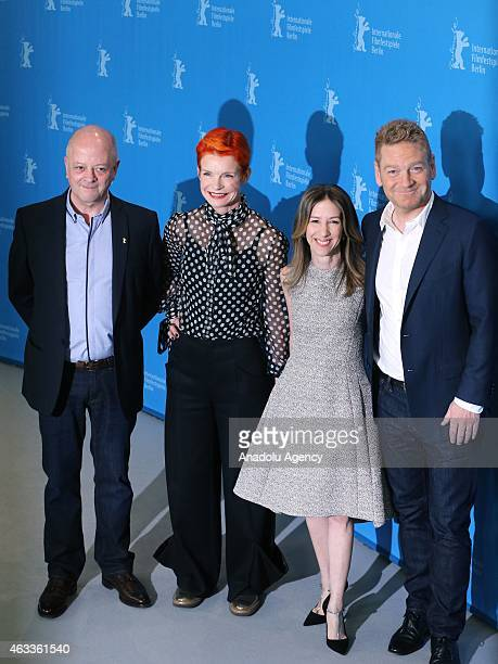 Producer David Barron costume designer Sandy Powell producer Alli Shearmur and director Kenneth Branagh pose during a photocall of 'Cinderalla' at...