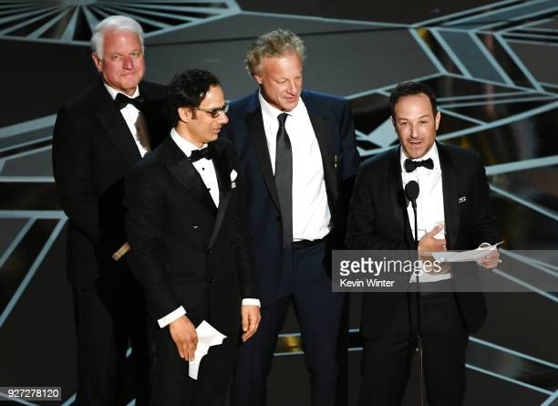 Producer David Fialkow director Dan Cogan producer James R Swartz and director Bryan Fogel accept Best Documentary Feature for 'Icarus' onstage...