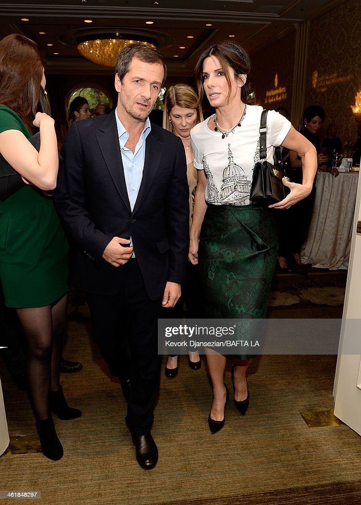 Producer David Heyman (L) and actress Sandra Bullock attends the BAFTA LA 2014 Awards Season Tea Party at the Four Seasons Hotel Los Angeles at Beverly Hills on January 11, 2014 in Beverly Hills, California.
