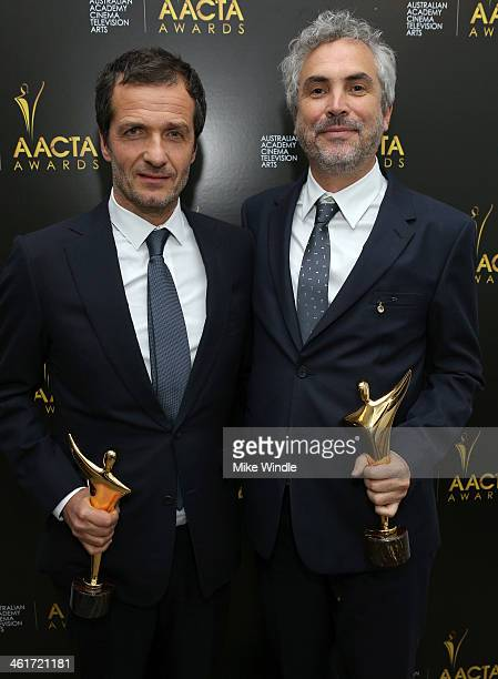 Producer David Heyman and director Alfonso Cuarón pose with the Best Film Award and Best Director Award during the 3rd AACTA International Awards at...