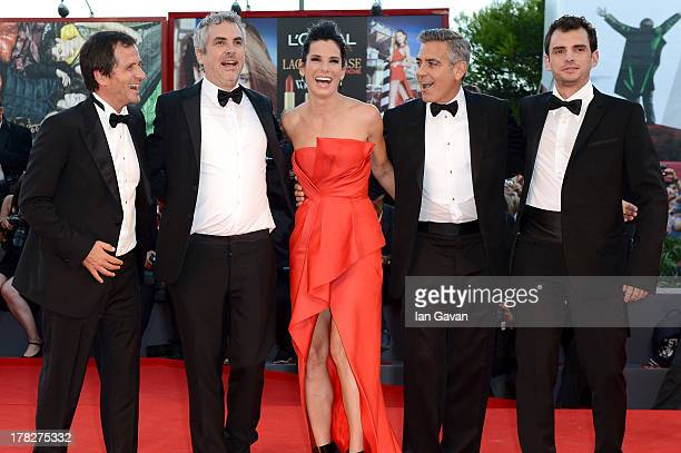 Producer David Heyman director Alfonso Cuaron actress Sandra Bullock actor George Clooney and screenwriter Jonas Cuaron attend the Opening Ceremony...