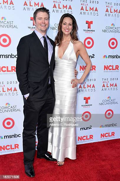 Producer David J Phillips and TV personality Mia Mastroianni arrive at the 2013 NCLR ALMA Awards at Pasadena Civic Auditorium on September 27 2013 in...