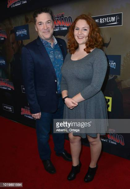 Producer David Latt and guest arrive for the Premiere Of The Asylum And Syfy's 'The Last Sharknado It's About Time' held at Cinemark Playa Vista on...