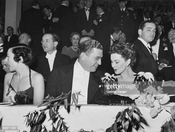 """Producer David O. Selznick chatting with actress Vivien Leigh at """"Gone With the Wind"""" premiere."""