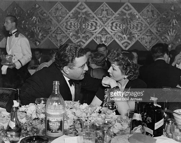 Producer David O Selznick talks with actress Claudette Colbert in Los Angeles California