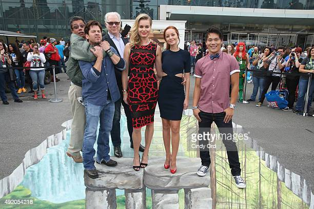 Producer Dean Devlin actors Christian Kane John Larroquette Rebecca Romijn Lindy Booth and John Kim pose at the TNT/TBS The Librarian Season 2 3D...