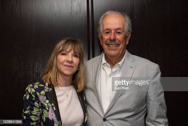Producer Denise Robert and director Denys Arcand and pose for a photo at ony Pictures Classics TIFF Celebration Dinner at Morton's on September 8,...