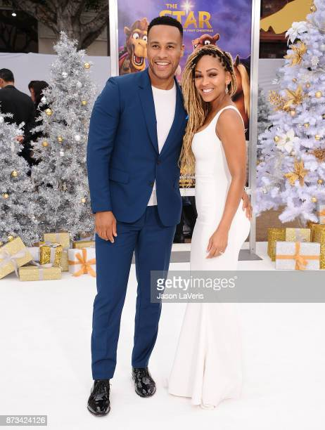 Producer DeVon Franklin and actress Meagan Good attend the premiere of 'The Star' at Regency Village Theatre on November 12 2017 in Westwood...