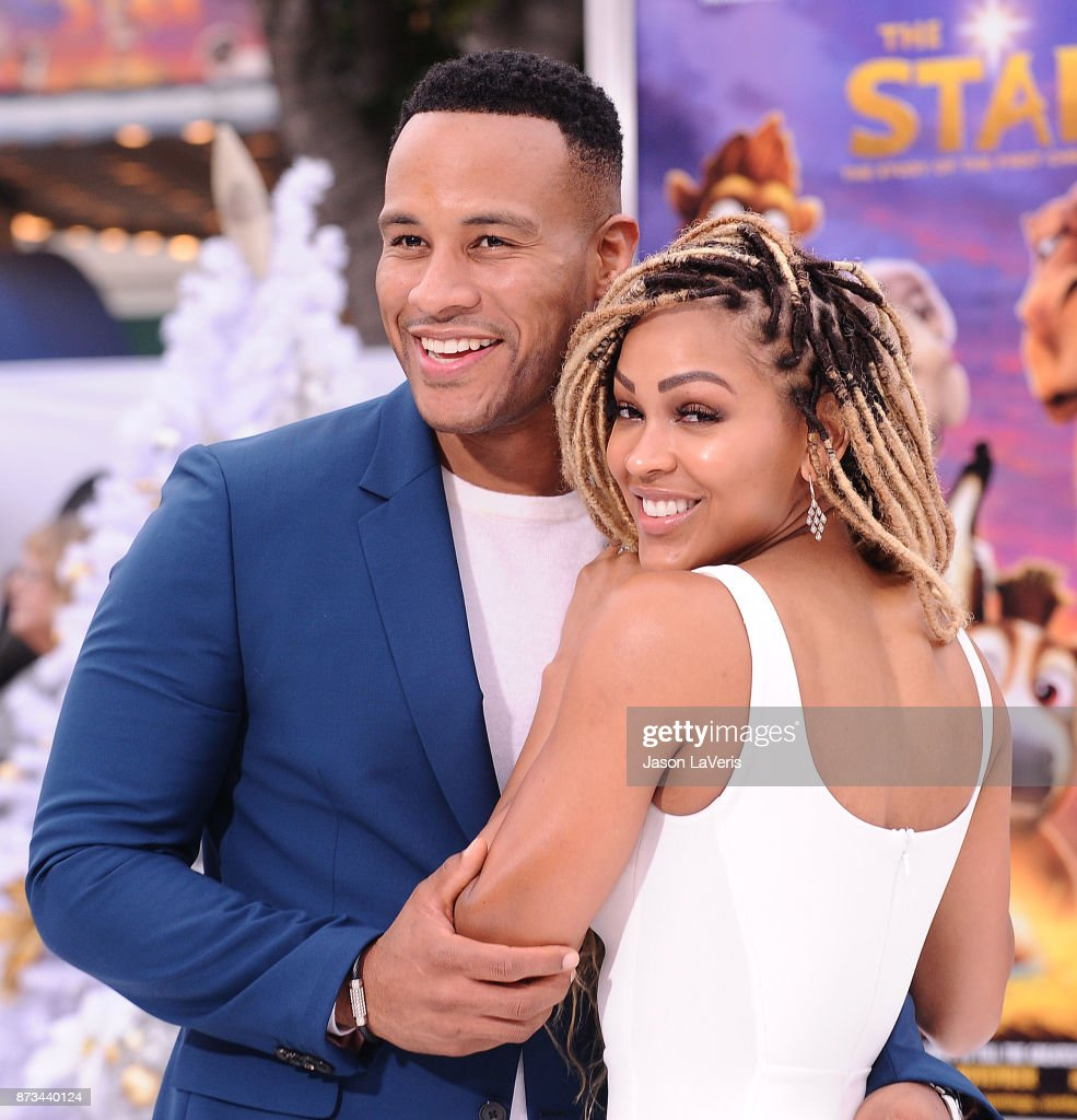 Producer DeVon Franklin and actress Meagan Good attend the premiere of 'The Star' at Regency Village Theatre on November 12, 2017 in Westwood, California.