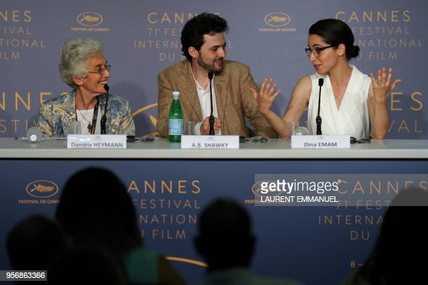 Producer Dina Emam speaks as Egyptian director AB Shawky and moderator French journalist Daniele Heymann listen during a press conference for the...