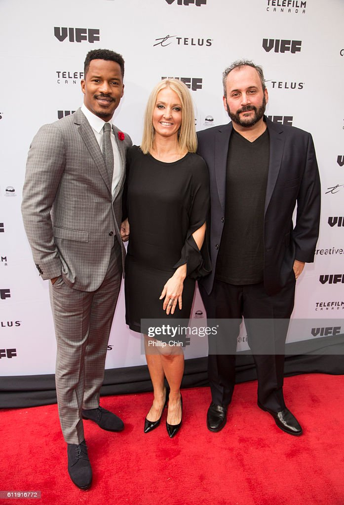 Producer, director, writer and actor Nate Parker, Vancouver International Film festival executive director Jacqueline Dupuis and producer Aaron Gilbert arrive on the red carpet for the film 'Birth of a Nation' at the Centre for the Performing Arts during the 35th Vancouver International Film Festival on Oct 1, 2016 in Vancouver, Canada.