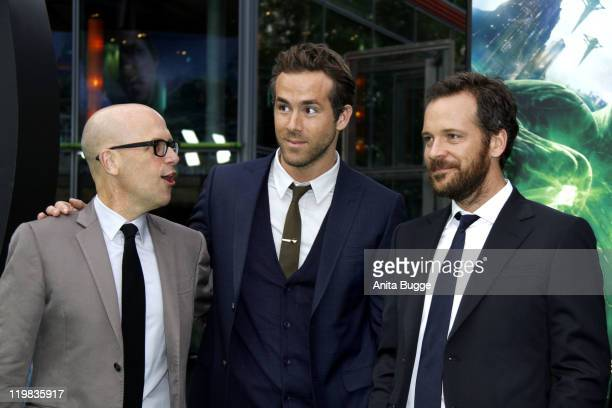 Producer Donald De Line and the actors Ryan Reynolds and Peter Sarsgaard attend the 'Green Lantern' Germany Premiere at CineStar on July 25 2011 in...