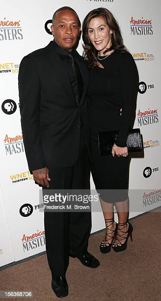 Producer Dr Dre and his wife Nicole Threatt attend the Premiere Of 'American Masters Inventing David Geffen' at The Writers Guild of America on...