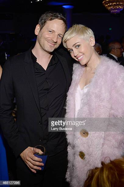 Producer Dr Luke and recording artist Miley Cyrus attend the 56th annual GRAMMY Awards PreGRAMMY Gala and Salute to Industry Icons honoring Lucian...