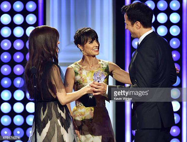 Producer Dwight D Smith accepts the Best Reality Series Competition for 'Face Off' from actors Shiri Appleby and Constance Zimmer onstage at the 5th...
