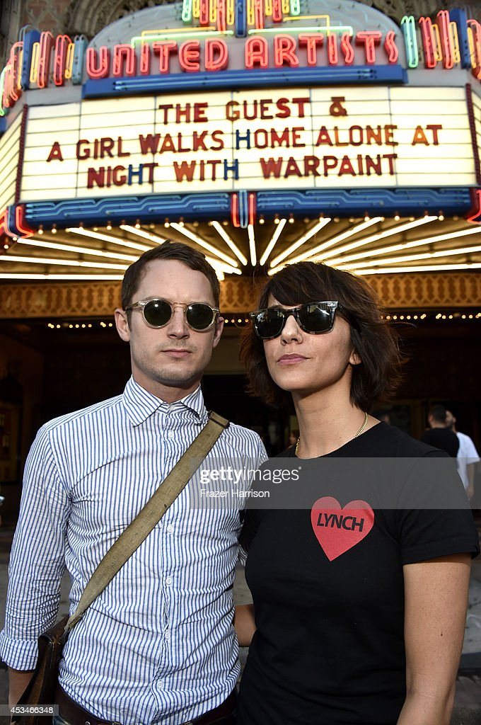 Producer Elijah Wood and director Ana Lily Amirpour (R) attend the screening of 'A Girl Walks Home Alone at Night' with Warpaint in concert during Sundance NEXT FEST at The Theatre at Ace Hotel on August 10, 2014 in Los Angeles, California.