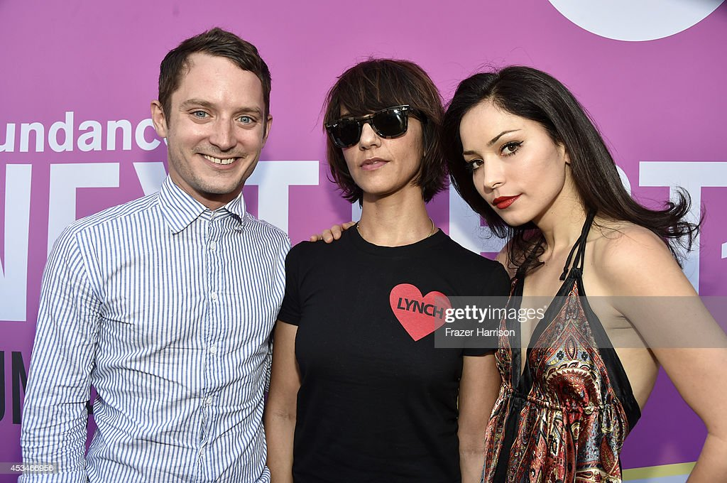 Producer Elijah Wood, director Ana Lily Amirpour, and actress Rome Shadanloo attend the screening of 'A Girl Walks Home Alone at Night' with Warpaint in concert during Sundance NEXT FEST at The Theatre at Ace Hotel on August 10, 2014 in Los Angeles, California.