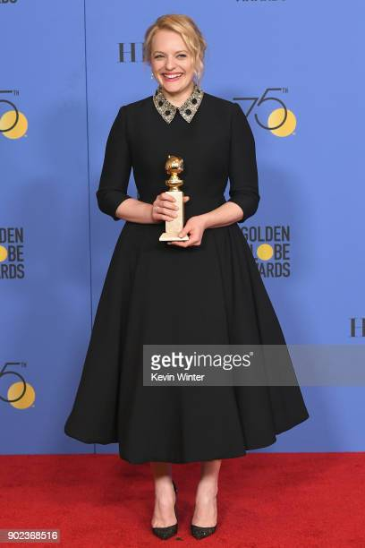 Producer Elisabeth Moss of 'The Handmaid's Tale' poses with the award for Best Television Series Drama in the press room during The 75th Annual...