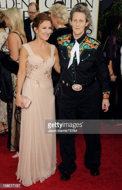Producer Emily Gerson and writer Temple Grandin arrive at the 68th Annual Golden Globe Awards held at The Beverly Hilton hotel on January 16 2011 in...