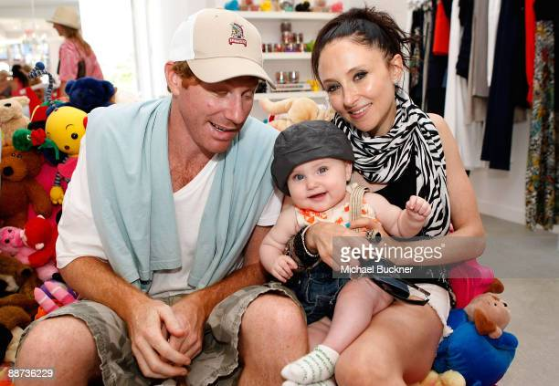 Producer Eric Eisner wife designer Stacey Bendet and daughter Eloise Breckenridge Eisner in aliceolivia during the EB Medical Research Foundation...