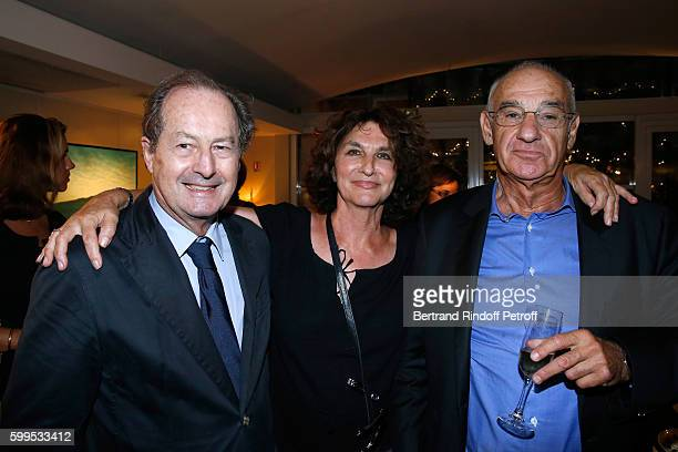 Producer Fabienne ServanSchreiber standing between her husband Henri Weber and Member of French Academy JeanMarie Rouart attend the Cezanne et Moi...