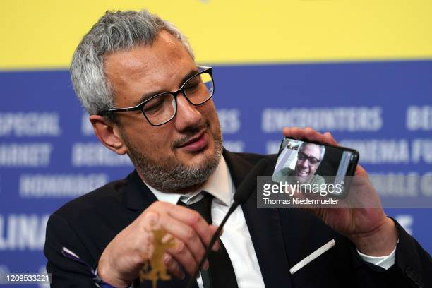 """Producer Farzad Pak phones Iranian director Mohammad Rasoulof, winner of the Golden Bear for Best Film for the film """"There Is No Evil"""" at the award..."""