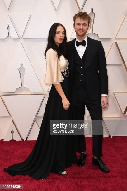 US producer Finneas and girlfriend Claudia Suleweski arrive for the 92nd Oscars at the Dolby Theatre in Hollywood California on February 9 2020