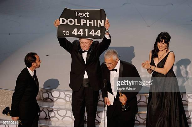Producer Fisher Stevens animal activist Ric O'Barry director Louie Psihoyos and producer Paula DuPre Pesman accept Best Documentary Feature award for...