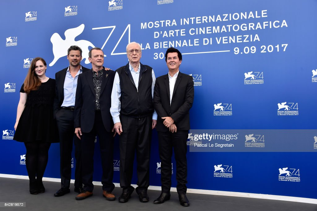 Producer Fodhla Cronin O'Reilly, David Batty, guest, Michael Caine and producer Simon Fuller attend the 'My Generation' photocall during the 74th Venice Film Festival at Sala Casino on September 5, 2017 in Venice, Italy.