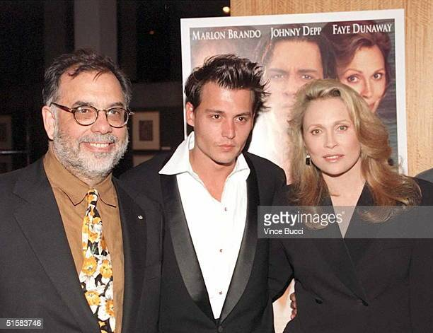Producer Francis Ford Coppola poses with costars Johnny Depp and Faye Dunaway at the 03 April premiere of the film Don Juan DeMarco in Beverly Hills...