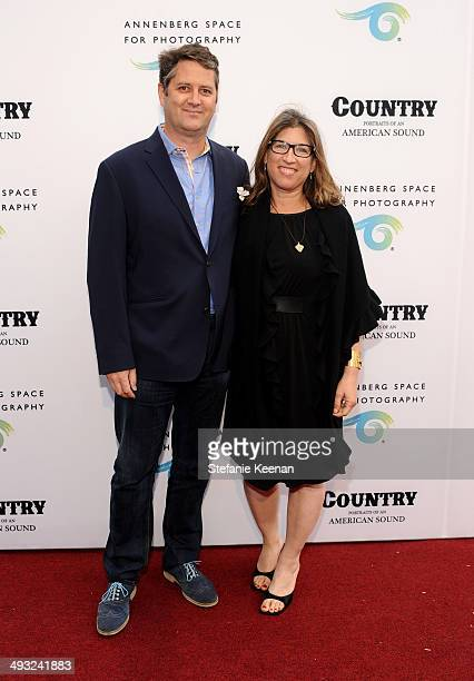 Producer Frank Evers and artist/filmmaker Lauren Greenfield attend the Annenberg Space for Photography Opening Celebration for Country Portraits of...