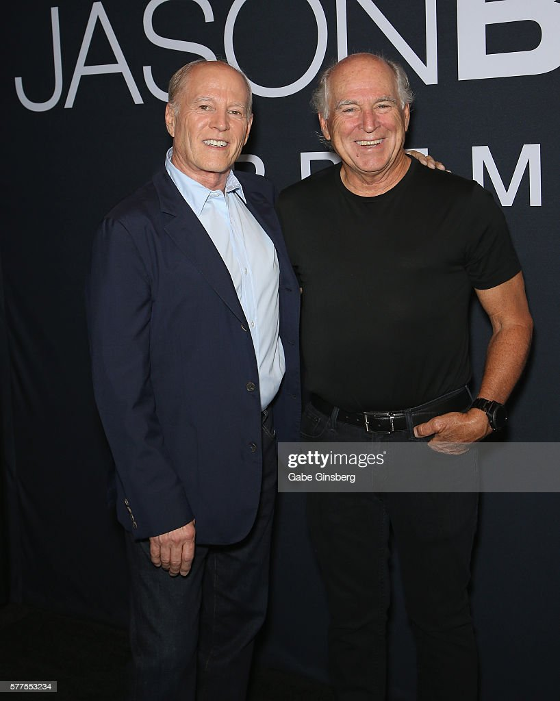 Producer Frank Marshall (L) and recording artist Jimmy Buffet attend the premiere of Universal Pictures' 'Jason Bourne' at The Colosseum at Caesars Palace on July 18, 2016 in Las Vegas, Nevada.