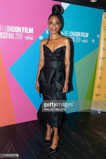 Producer Funni Iyanda poses as she arrives to attend the Walking With Shadows UK Premiere during the 63rd BFI London Film Festival at the Curzon Soho...